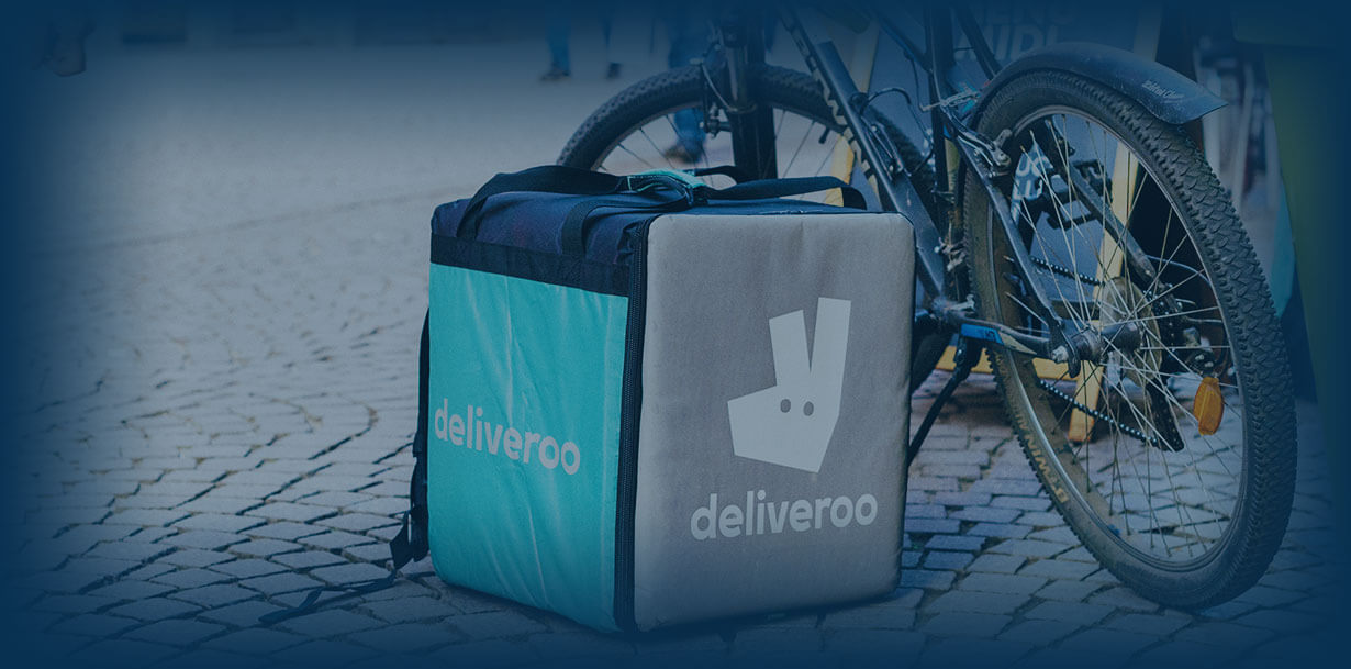 Deliveroo bag next to bicycle